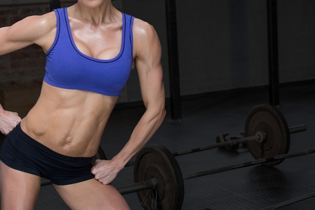Digital composite of Female fitness instructor with perfect body