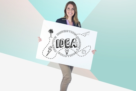 Digital composite of Businesswoman holding bill board with idea graphics on it Stock Photo