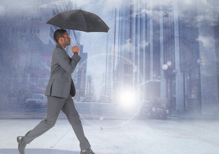 Digital composite of Businessman walking with umbrella in city