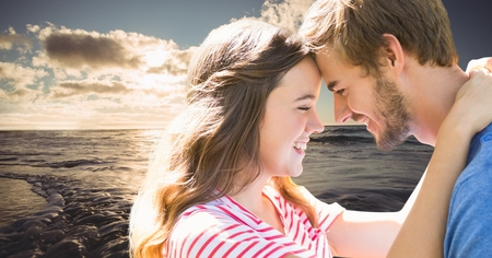 smolder: Digital composite of Romantic young couple head to head against sea Stock Photo