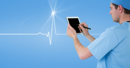 Digital composite of Male doctor using tablet PC with human diagram in background