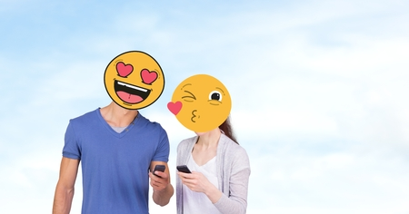 Digital composite of Couple with emojis over faces using mobile phones