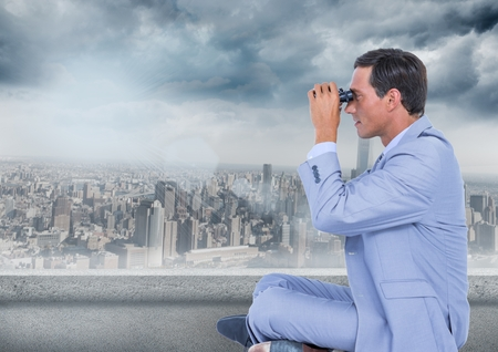 Digital composite of Business man with bionoculars against grey skyline and clouds