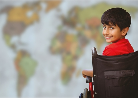 Digital composite of Boy in wheelchair against blurry map
