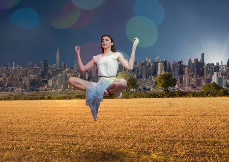 Digital composite of up side down city.  woman meditating on the lamb Stock Photo