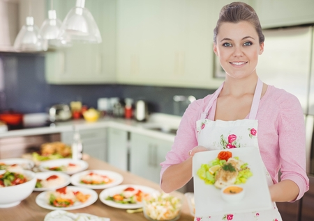 statics: Digital composite of woman showing the plate in the kitchen