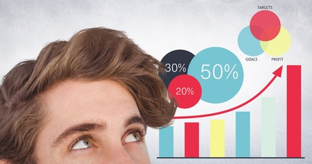 statics: Digital composite of Top of mans head against graphs and white wall Stock Photo