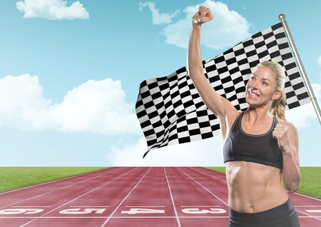 Digital composite of Female runner with hand in air on track against sky and checkered flag
