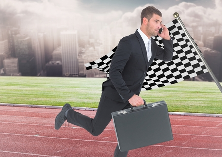 Digital composite of Business man on phone with briefcase and running on track against skyline with clouds and checkered
