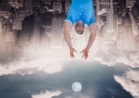 Digital composite of up side down city. omen with ball