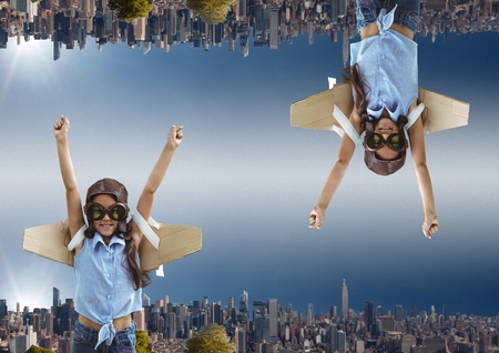 Digital composite of up side down city. sky background girl wants to fly Stock Photo