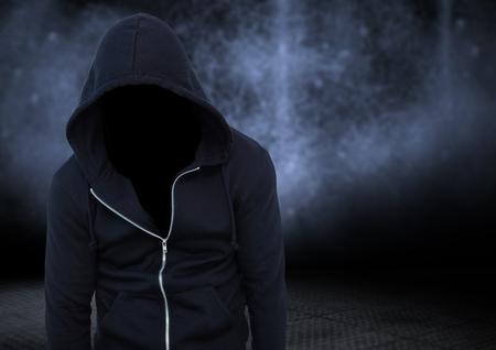 intruding: Digital composite of Anonymous criminal against dark background