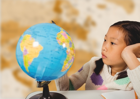 mapa china: Digital composite of Girl at desk with globe against blurry brown map Foto de archivo