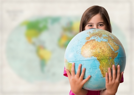 Digital composite of Girl with globe against blurry map