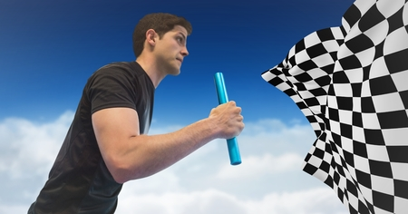 Digital composite of Relay runner against clouds and blue sky and checkered flag Stock Photo