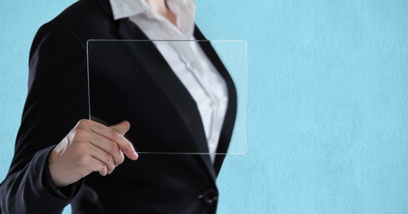 midsection: Digital composite of Midsection of businesswoman holding transparent device Stock Photo