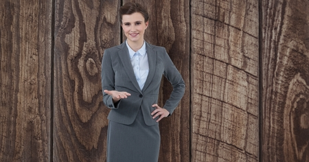 panelling: Digital composite of Businesswoman gesturing over wooden wall Stock Photo