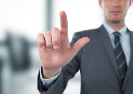 midsection: Digital composite of Midsection of businessman gesturing in office Stock Photo