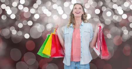 Digital composite of Woman with carrying shopping bags over bokeh