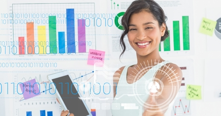 tablet pc in hand: Digital composite of Happy businesswoman holding digital tablet against graphs