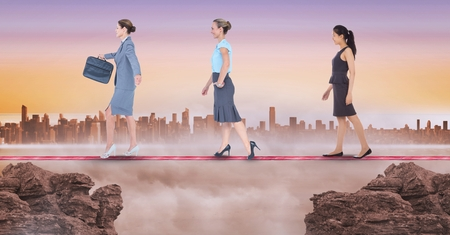 Digital composite of Digital composite image of businesswomen walking on rope during sunset