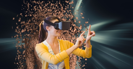 Digital composite of Woman wearing VR glasses with 3d scattered human figure in background