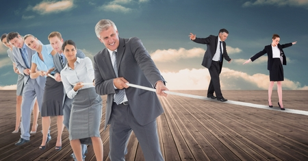 Digital composite of Business people walking on rope while colleagues pulling it on boardwalk