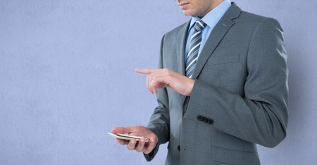 midsection: Digital composite of Midsection of businessman holding mobile phone while gesturing over purple background