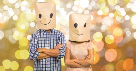 Digital composite of Couple with emojis on cardboard boxes over bokeh Stock Photo