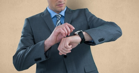 midsection: Digital composite of Midsection of businessman checking time