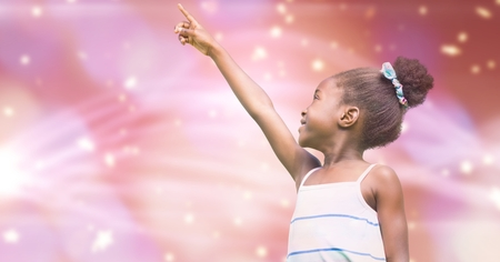 Digital composite of Little girl pointing away against blur background