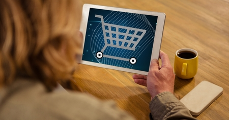 white wave: Digital composite of Woman looking at shopping cart icon on tablet PC