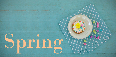 Easter greeting against cookie served with chocolates in a tray Stock Photo