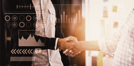 introducing: Light with a white background against businessmen having a handshake Stock Photo