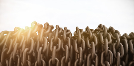 3d image of rusty chains connected against landscape Фото со стока
