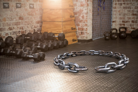 3d image of circular broken chain against dumbbells and kettlebell Stock Photo