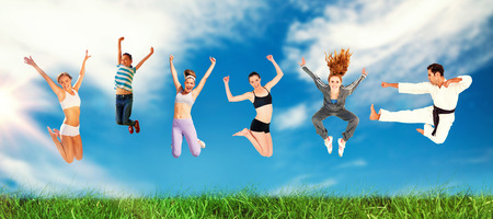 Man and women jumping over white background against view of a blue sky
