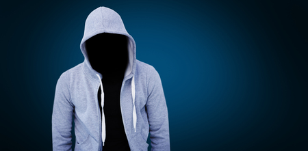 Robber wearing gray hoodie against blue background with vignette
