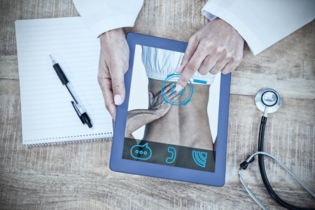 doctor tablet: Man suffering from back pain against doctor using digital tablet