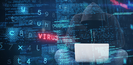 Male hacker using laptop while sitting against virus background