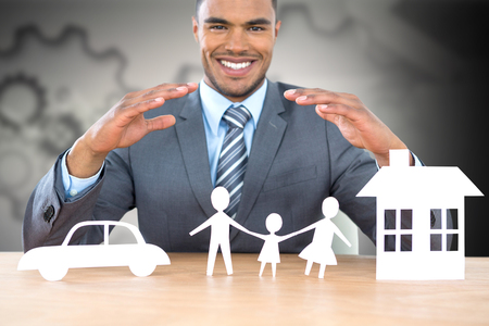 insurer: Businessman smiling behind car, family and house illustration against arrows with gears