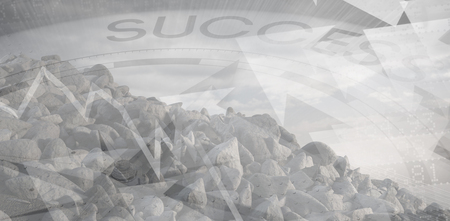 innumerable: Grey rocks against success text with graphs and compass Stock Photo