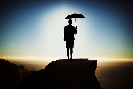 black woman with umbrella against scenic view of mountain by sea against sky
