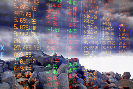 non stock: pile of rocks against stocks and shares Stock Photo