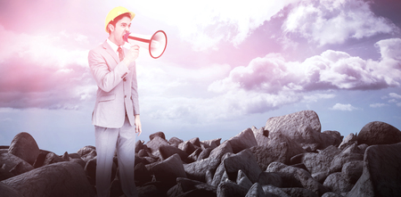 innumerable: Young architect yelling with a megaphone against blue sky