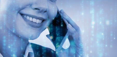 Close up of smiling businesswoman talking on mobile phone against digitally generated black and blue matrix