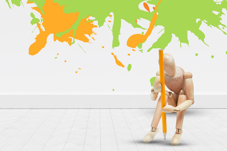 Colourful paint splashes against gray flooring and wall Stock Photo