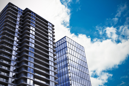 smart goals: 3d illustration of modern buildings against view of beautiful sky and clouds Stock Photo