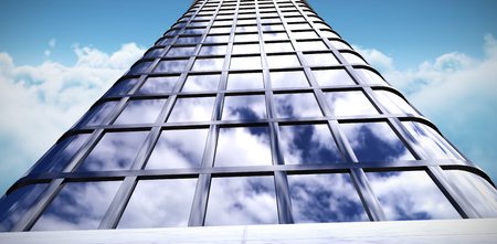 Low angle view of office building against idyllic view of white cloudscape against sky Stock Photo