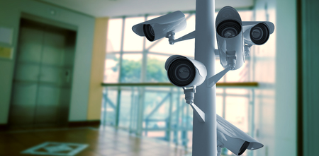 CCTV camera against foyer area with elevator Stock Photo